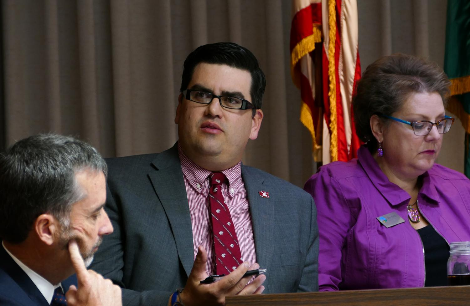 Councilmember Brandon Chapman, center, asks questions during the meeting Tuesday.