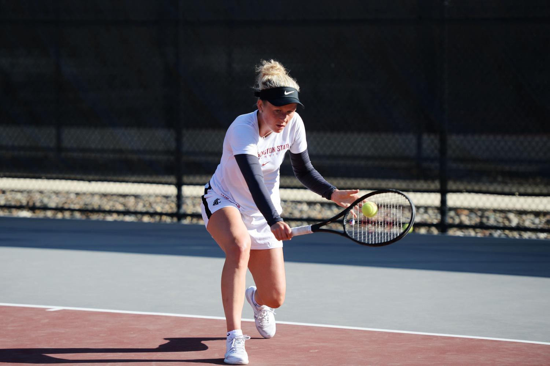 Senior tennis player Aneta Miksovska practices Sept. 19 on Rec Center Tennis courts.