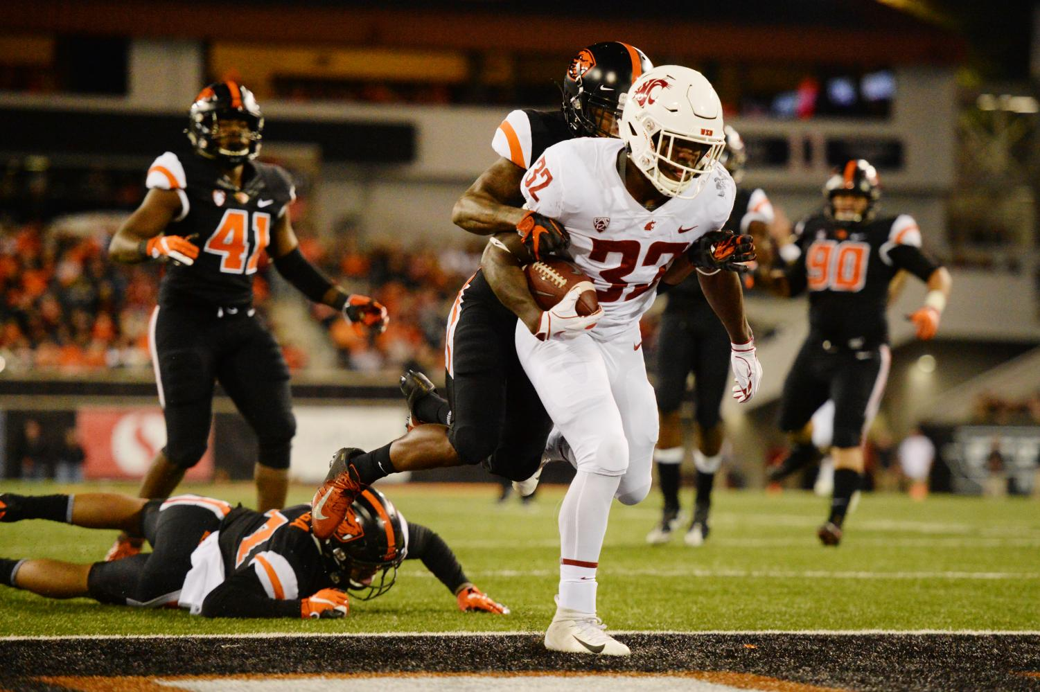 Redshirt junior running back James Williams breaks through the Oregon State University defense and runs the ball into the end zone for a touchdown in the second quarter Saturday at Reser Stadium in Corvallis.
