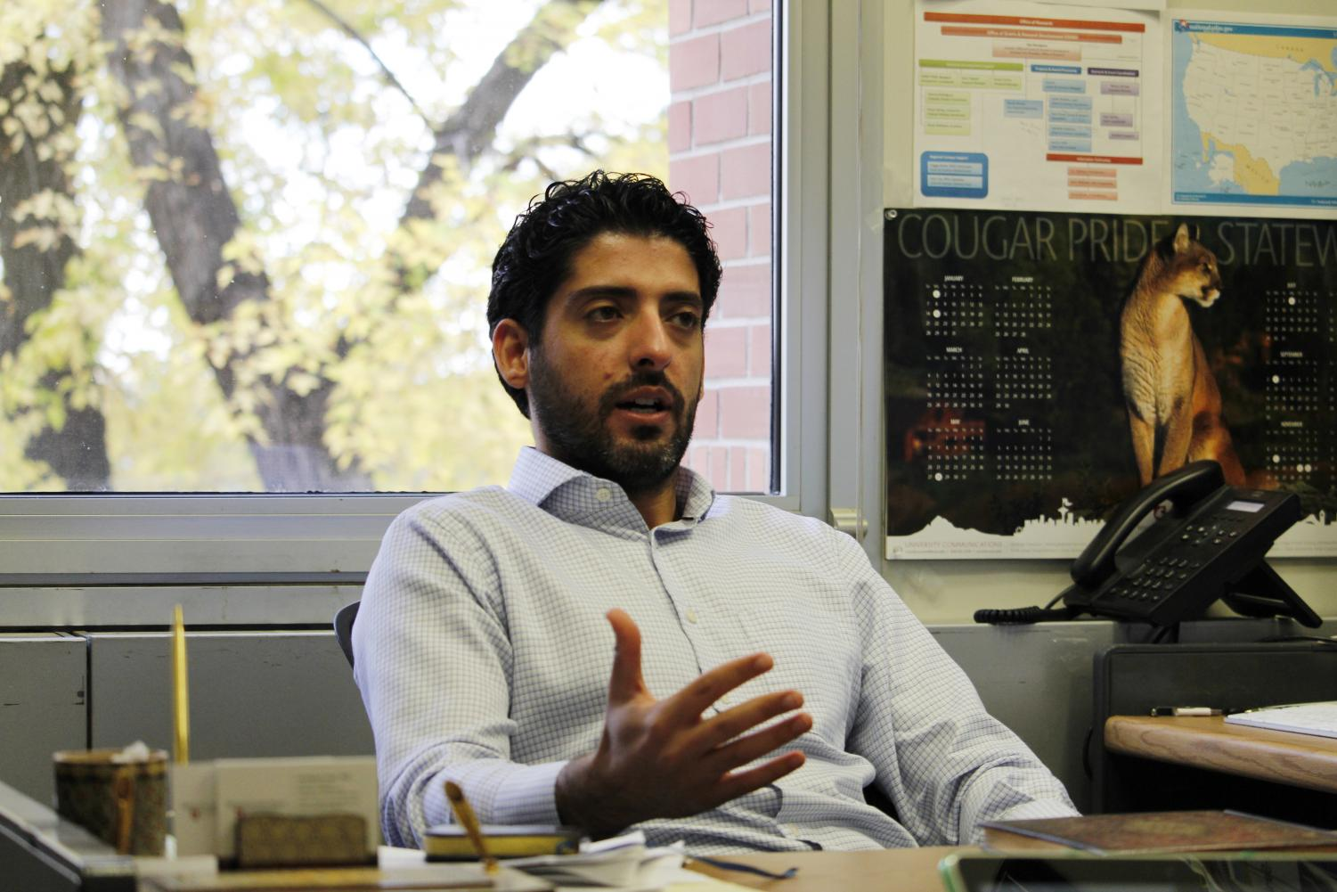 Associate Professor Ali Mehrizi-Sani discusses different types of renewable energy and its benefits on Wednesday in the Electrical-Mechanical Engineering Building.