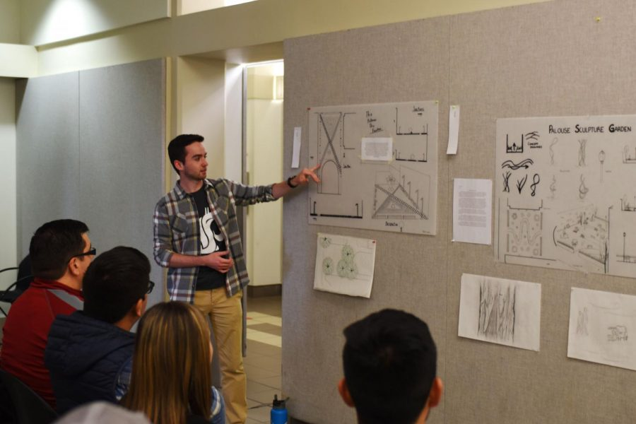 Mark+Lees%2C+junior+landscape+architecture+major%2C+discusses+his+inspiration+for+a+waterfall+illuminated+by+LED+on+Monday+at+Carpenter+Hall.
