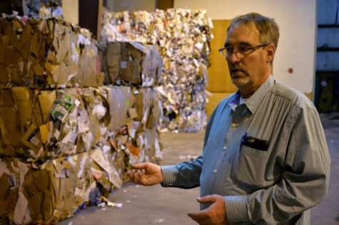 """We're trying to ... make an emphasis on reducing contamination and [increasing] clean recycling,"" Rick Finch, WSU waste management manager, said as he shows compacted cardboard bales in the WSU Surplus Stores."
