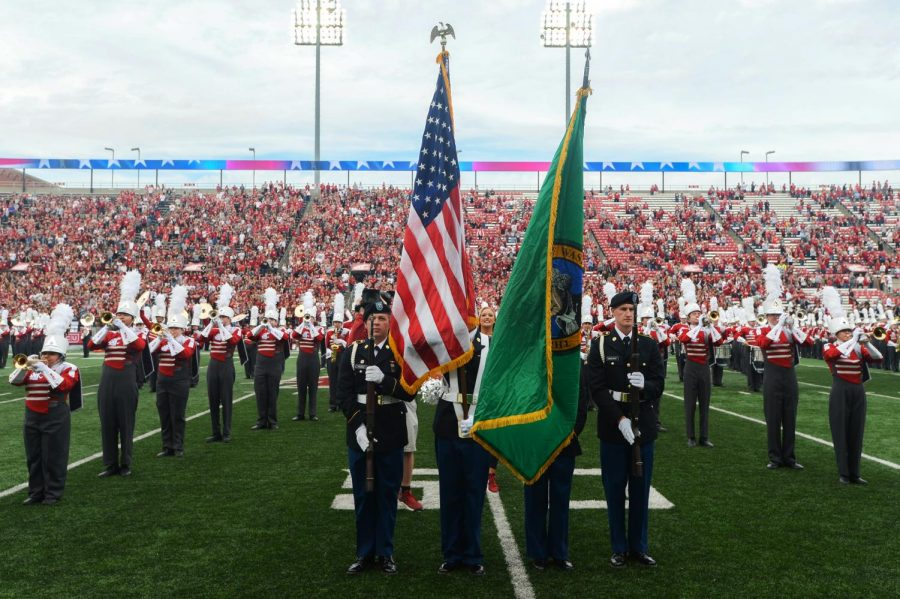 The+WSU+Marching+Band+plays+the+national+anthem+while+the+military+color+guard+protects+the+flags+before+the+game+against+Utah+on+Saturday+at+Martin+Stadium.+Patriotism+is+more+about+values+than+it+is+about+land+and+conflating+the+two+is+inaccurate.
