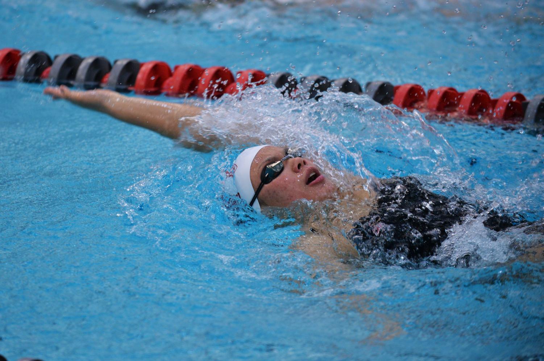 Freshman backstroke and butterfly swimmer Sophia Balmaceda races in the women's 200 backstroke against University of Wyoming on Friday at Gibb Pool.