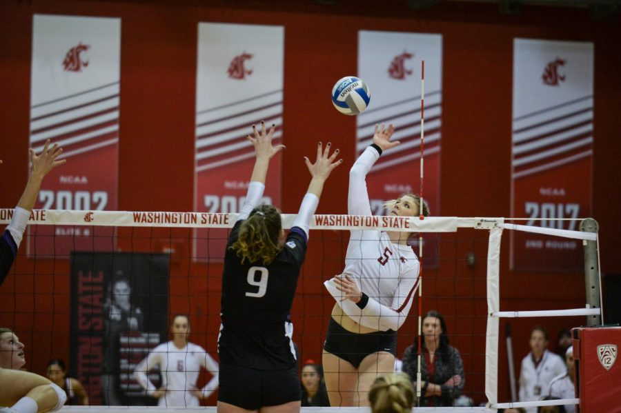 Senior+outside+hitter+McKenna+Woodford+hits+the+ball+against+University+of+Washington+on+Saturday+in+Bohler+Gym.
