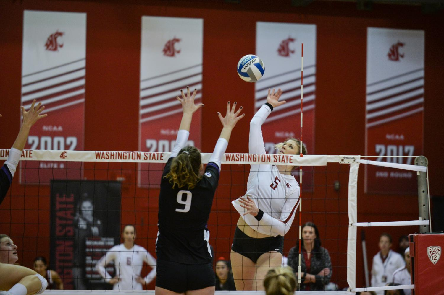 Senior outside hitter McKenna Woodford hits the ball against University of Washington on Saturday in Bohler Gym.