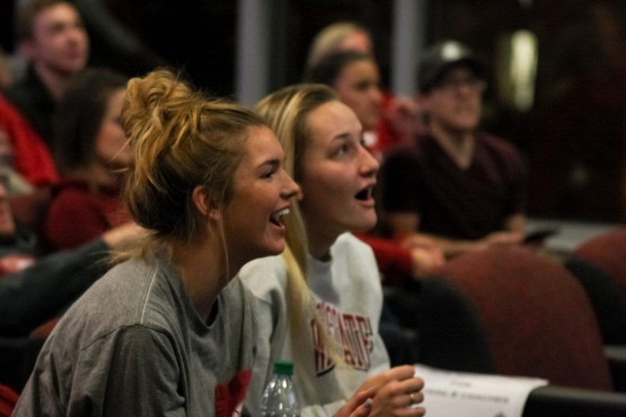 """Senior defensive specialist Olivia Coale, left, and junior setter Ashley Brown, right, react to the announcement of the Cougars seeding in the first round of the NCAA Tournament on Sunday night in Martin Stadium. """"This is the first time since we've been coaching that we know we're going to the tournament,"""" Head Coach Jen Greeny said before the NCAA Selection Show began on ESPNU."""