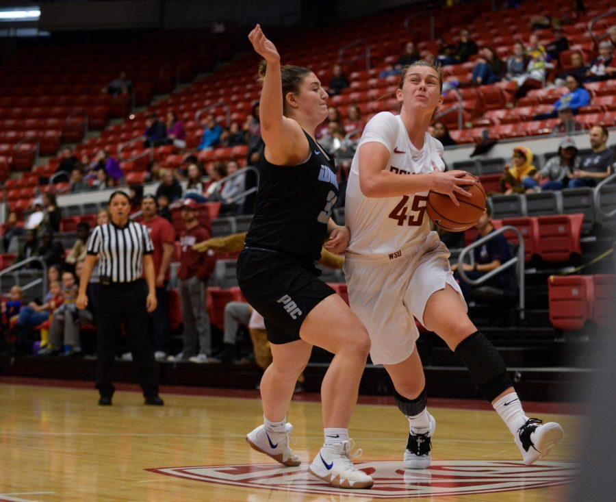 Redshirt junior forward Borislava Hristova pushes past Warner Pacific defense in an attempt to score Monday at Beasley Coliseum.