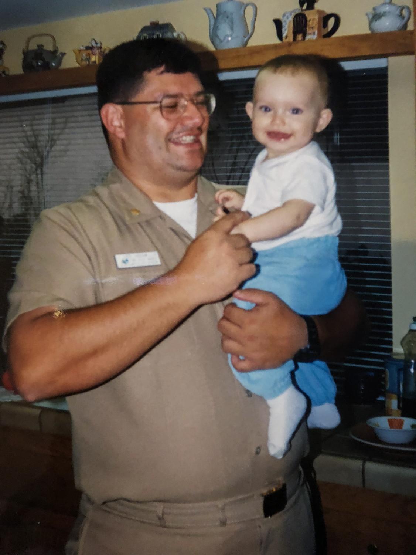 Eduardo Jaramillo, left, holds daughter Carmen in San Diego while on shore leave in 1998.