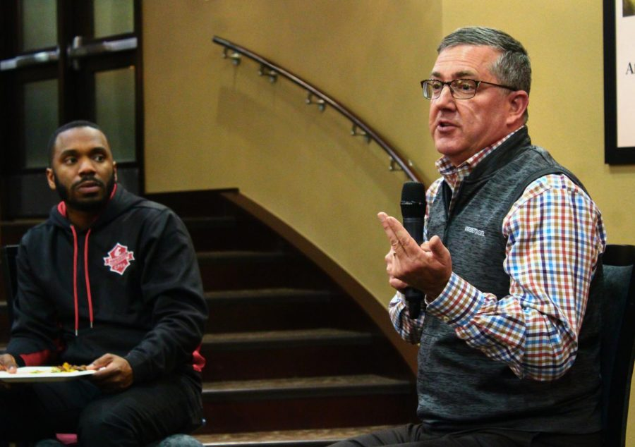 GPSA President Amir Gilmore, left, listens as WSU President Kirk Schulz answers questions at the GPSA Chat and Chew event Tuesday night.