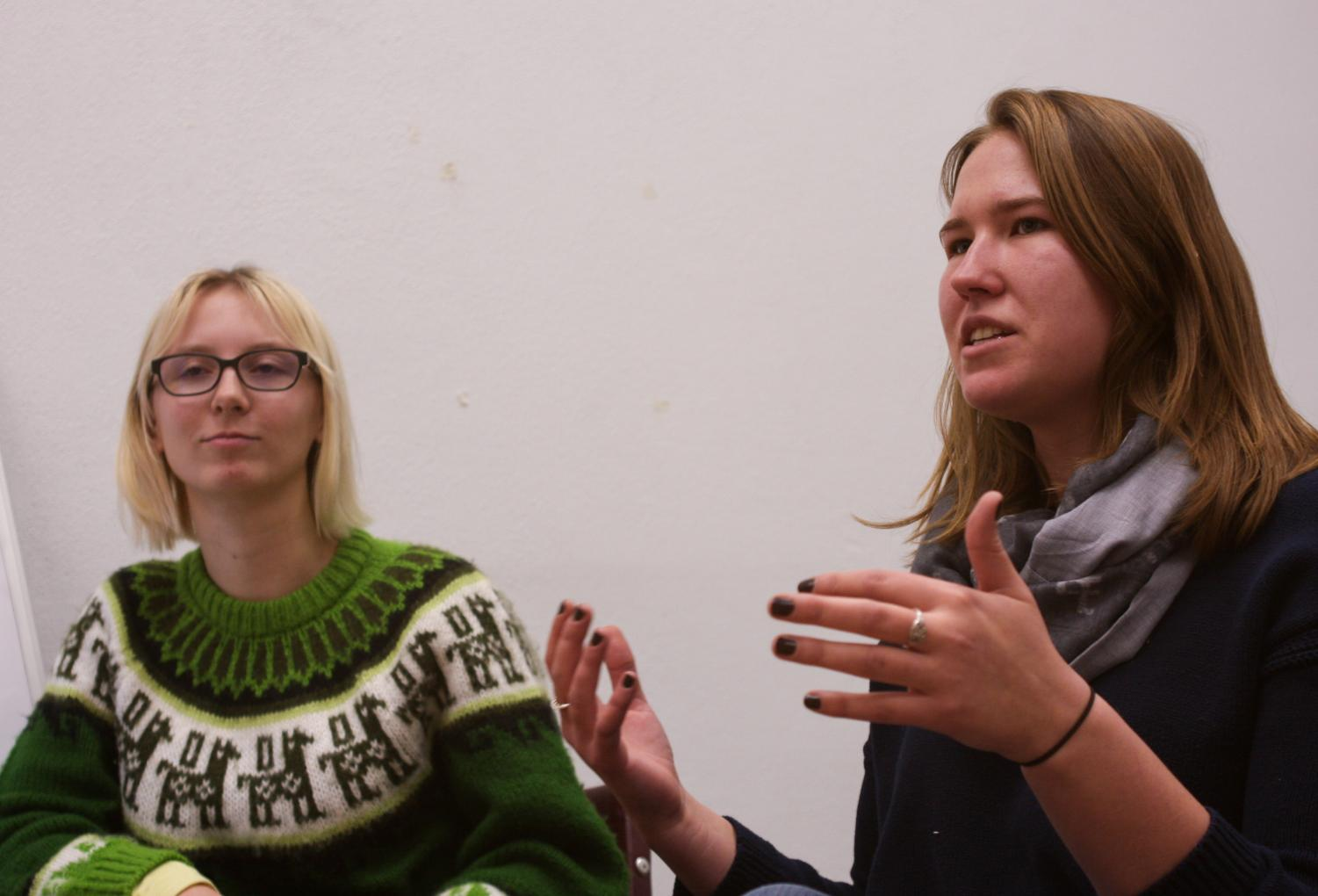 Co-presidents Jennifer Beyer, left, and Laila Reimanis explain their goal for the Environmental Science Club to raise zero waste awareness Tuesday in Fulmer Hall.