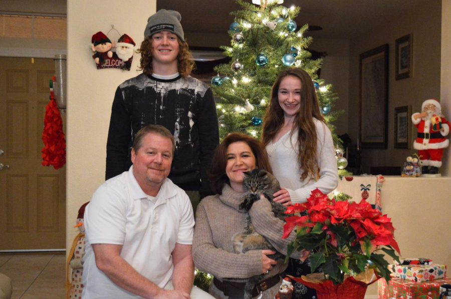 Managing editor Sydney Brown's stepbrother Mitchell Miller (top, left), sister Alex Brown (top, right), stepfather Mitchell Todd Miller (bottom, left) and mother Sally Miller (bottom, right) pose with their cat, Mao