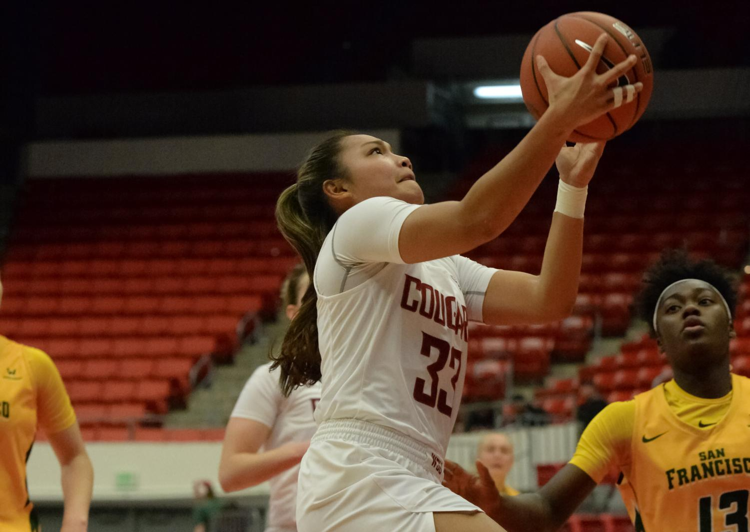 Freshman guard Cherilyn Molina runs up the court for a layup against San Francisco on Nov. 29 at Beasley Coliseum.
