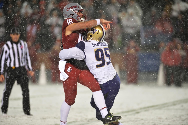 Quarterback Gardner Minshew II gets tackled by Washington sophomore defensive lineman Levi Onwuzurike during the Apple Cup on Nov. 23 at Martin Stadium.
