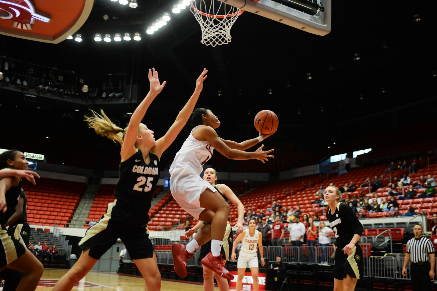 Junior guard Chanelle Molina goes up for a layup during the game against Colorado last Sunday at Beasley Coliseum.