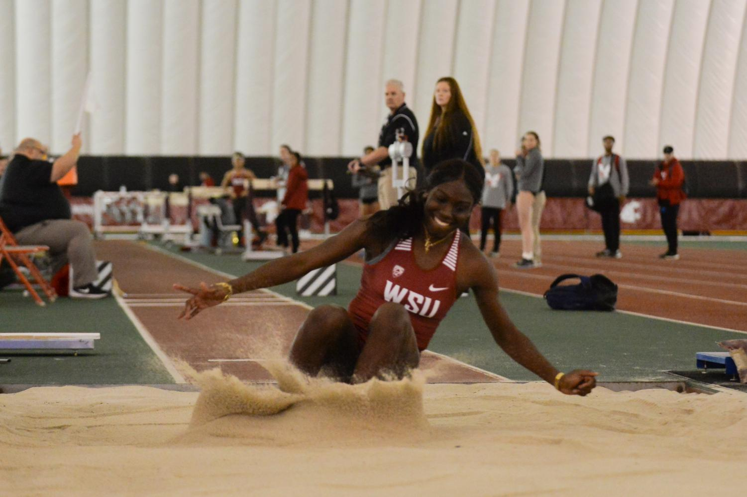 Freshman triple jump Charisma Taylor completes a successful jump at the WSU Open Indoor Open on Friday at the Indoor Practice Facility.