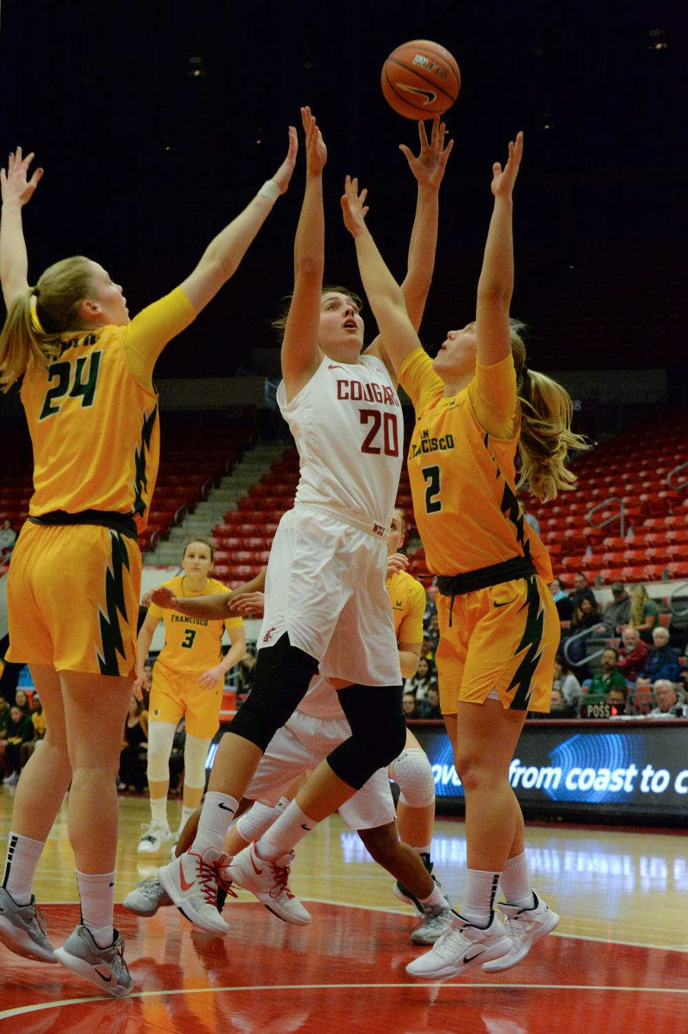 an Francisco players attempt to block WSU senior center Maria Kostourkova's shot during a game Nov. 29 at Beasley Coliseum.