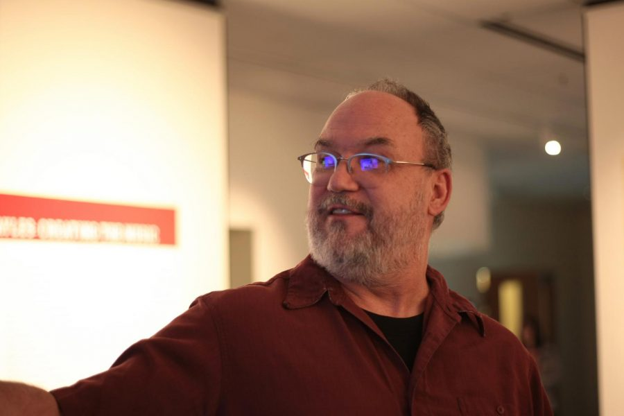 University+archivist+Mark+O%E2%80%99English+talks+about+the+WSU+fight+song%E2%80%99s+impact+Tuesday+at+an+exhibit+in+WSU+libraries+Manuscripts%2C+Archives+and+Special+Collections.