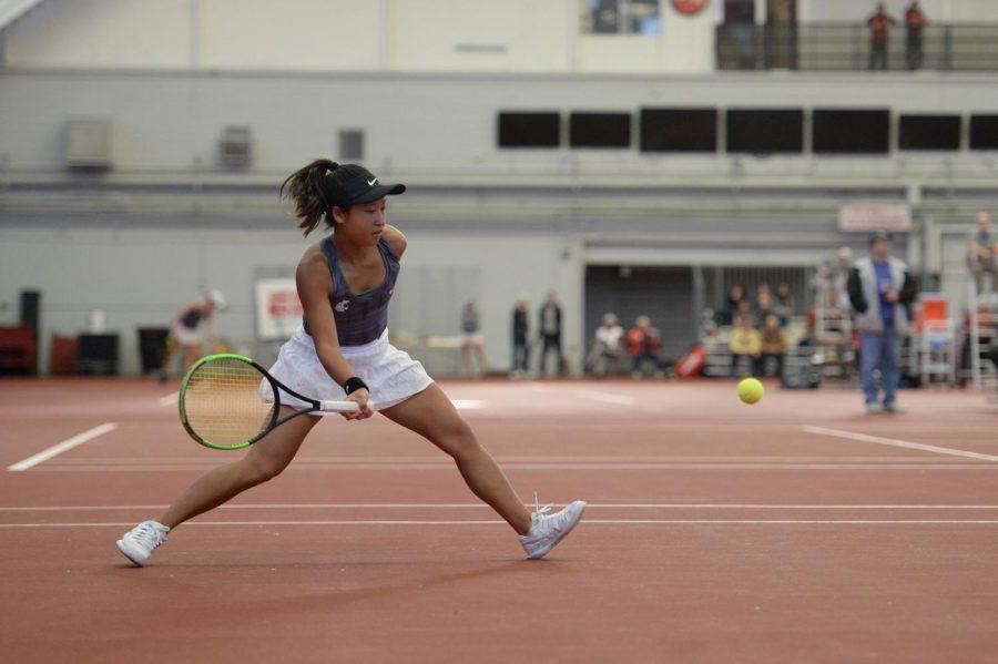 Freshman Savanna Ly-Nguyen prepares to return a ball during her singles match against Idaho's Anna Stefani on Jan. 12 at Hollingbery Fieldhouse.