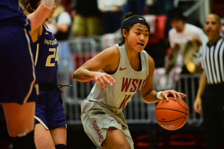 WSU+junior+guard+Chanelle+Molina+dribbles+past+UW+players+Friday+night+at+Beasley+Coliseum.