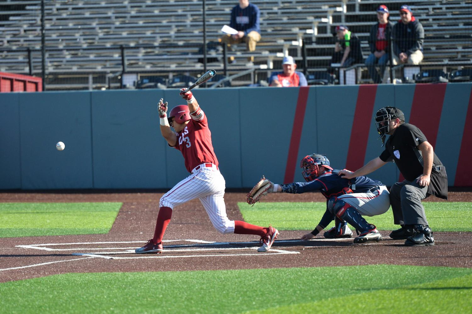 Senior infielder Andres Alvarez attempts to hit the ball in a game against Gonzaga on Oct. 21  at Bailey-Brayton Field.