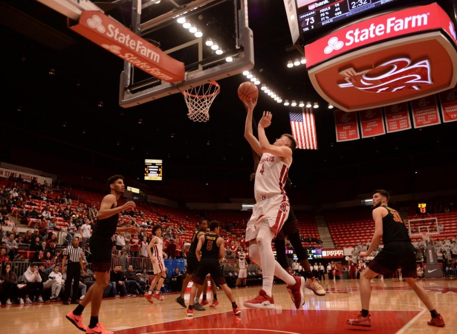Freshman+small+forward+Aljaz+Kunc+leaps+as+he+shoots+for+the+net+during+the+game+against+USC+on+Feb.+2+at+Beasley+Coliseum.