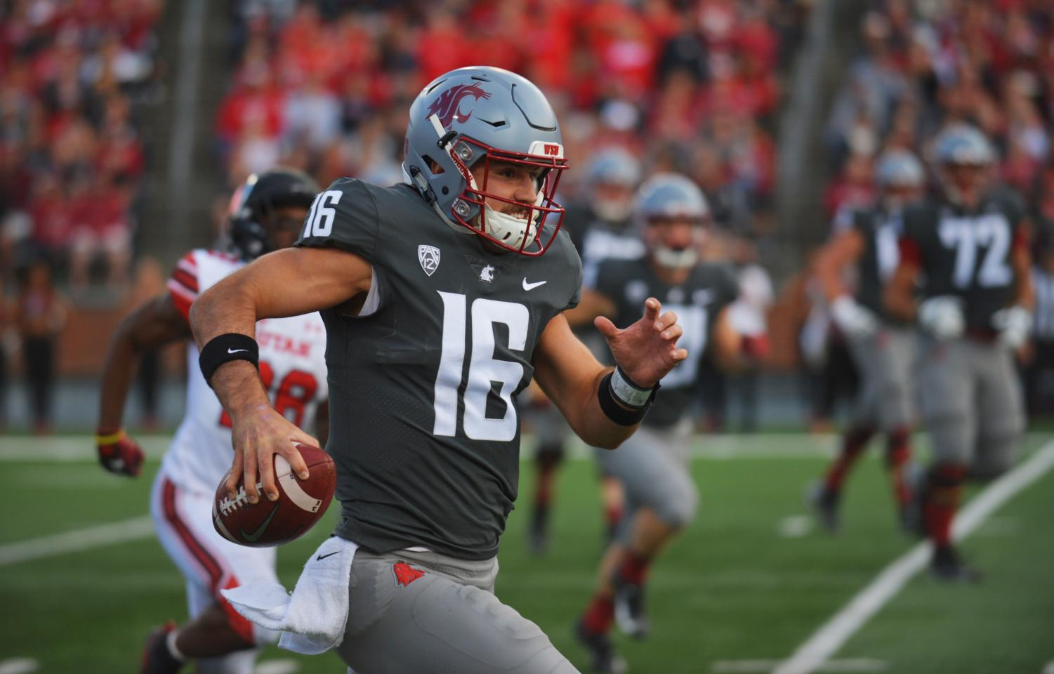Quarterback Gardner Minshew II runs the ball down field for a gain of yards in the game against University of Utah on Sept. 30 at Martin Stadium.