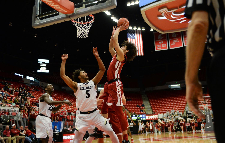 Freshman Forward CJ Elleby jumps over the CU defense as he shoots in the WSU vs. CU basketball game Feb. 20 at Beasley Coliseum.