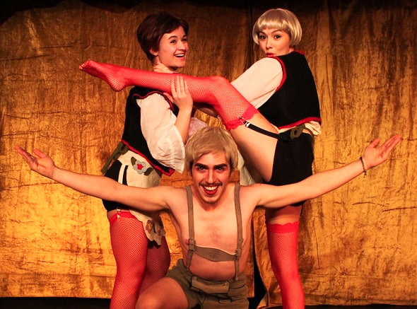 "Victoria Zenner, left, and Isa Davidson, right, play dancers at the Kit Kat Klub in RTOP's production of ""Cabaret."" Jasper Barbosa Rodriguez-Vivaldi, center, plays the Emcee in the musical."