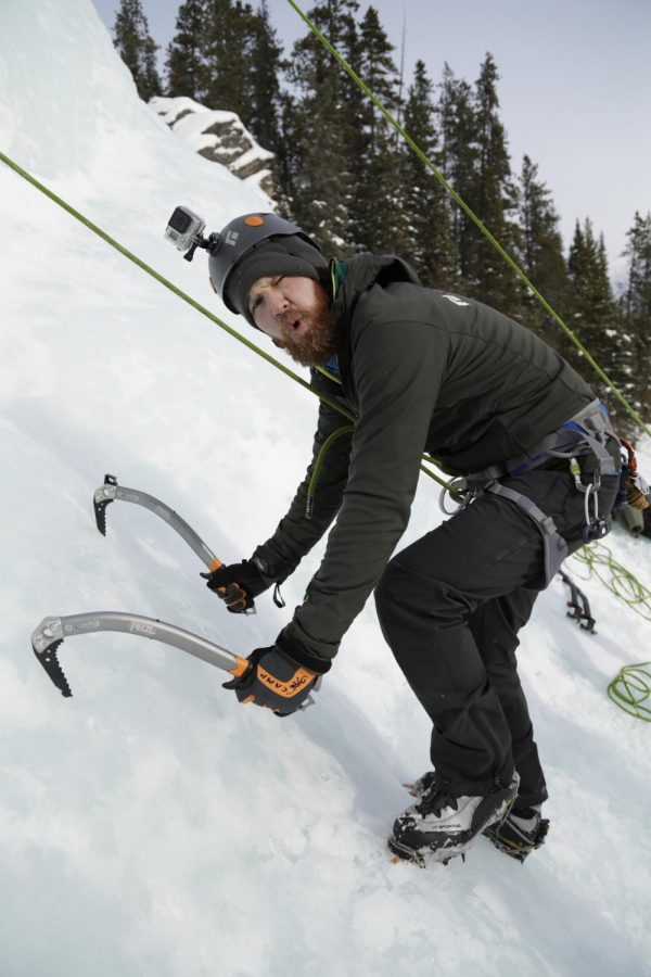 Jacob Jones, a Whitman County news reporter, begins his climb up the 45-foot-tall ice sheet Saturday at the Canmore Junkyards in Alberta, Canada.
