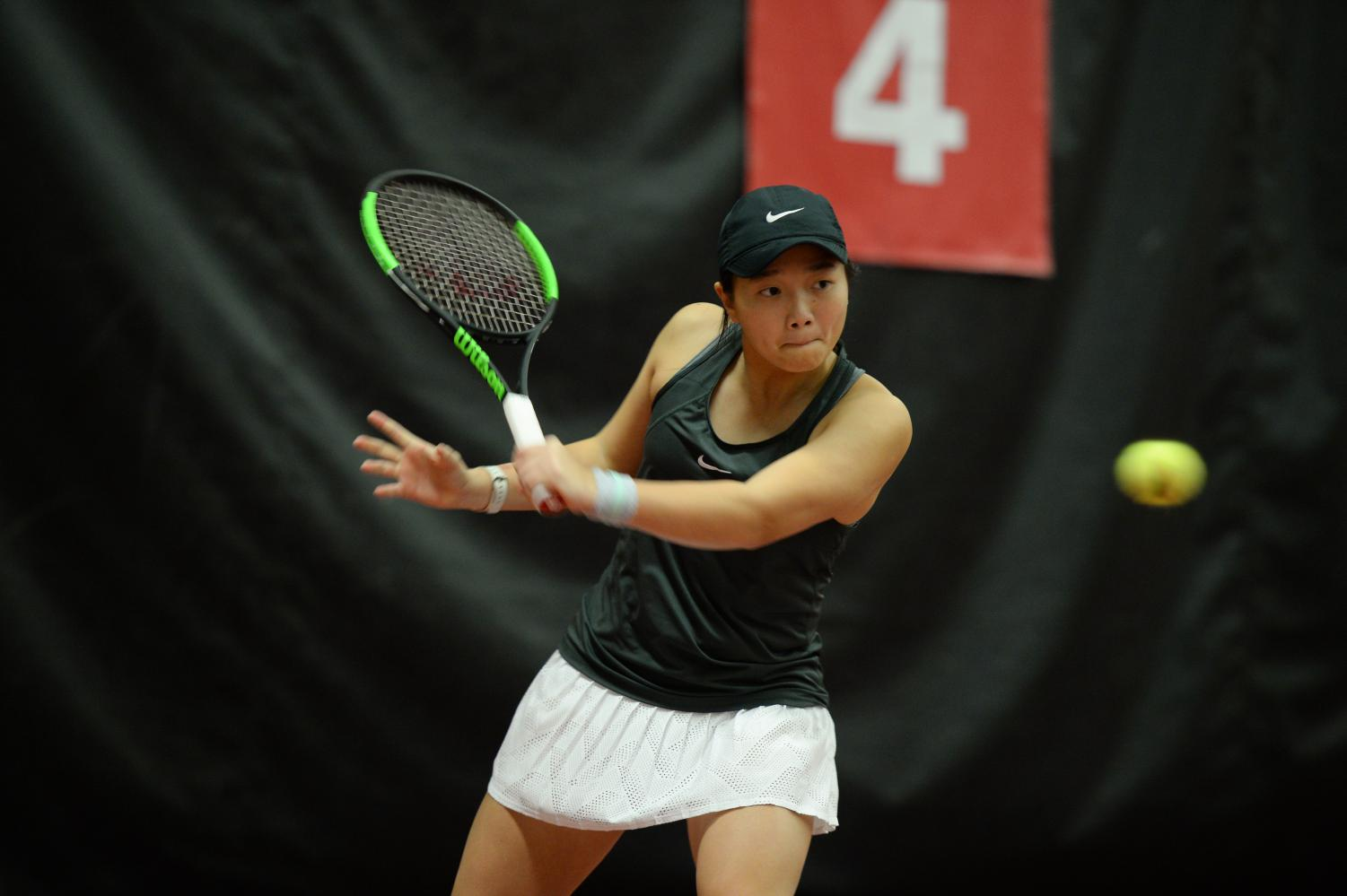 WSU Freshman Yang Lee returns a ball during singles play against Seattle U on Feb. 22 in Hollingbery Fieldhouse. Lee won her match in straight sets. Lee enjoys being a Cougar as well as spending time with her fun team.