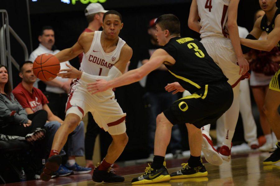 Junior guard Jervae Robinson dribbles past Oregon junior guard Payton Pritchard on Wednesday night at Beasley Coliseum.