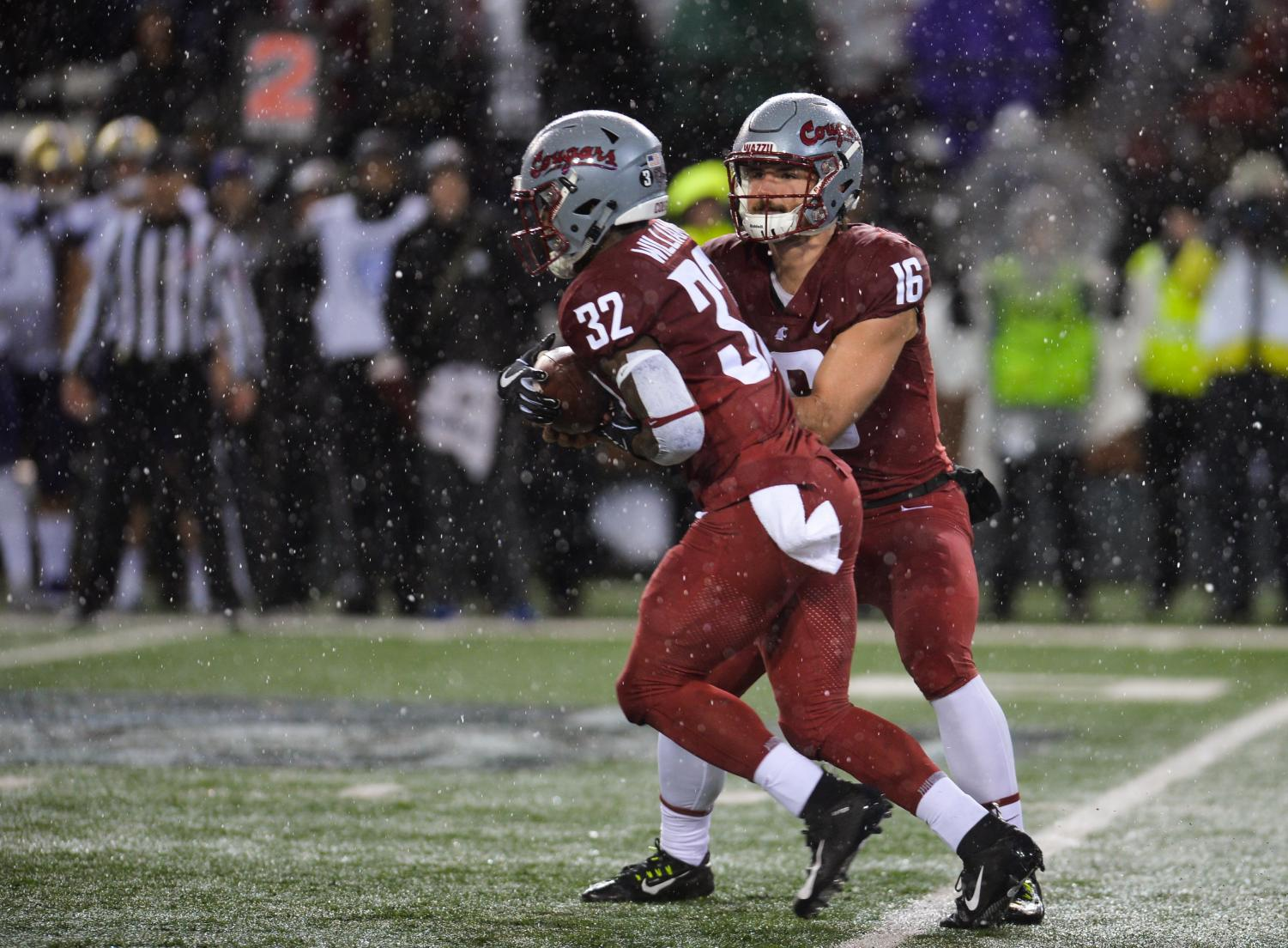 "Then-graduate transfer quarterback Gardner Minshew II hands the ball off to redshirt junior running back James ""Boobie"" Williams in the Apple Cup matchup against UW on Nov. 23 in Martin Stadium. Three Cougs competed in the NFL Combine."