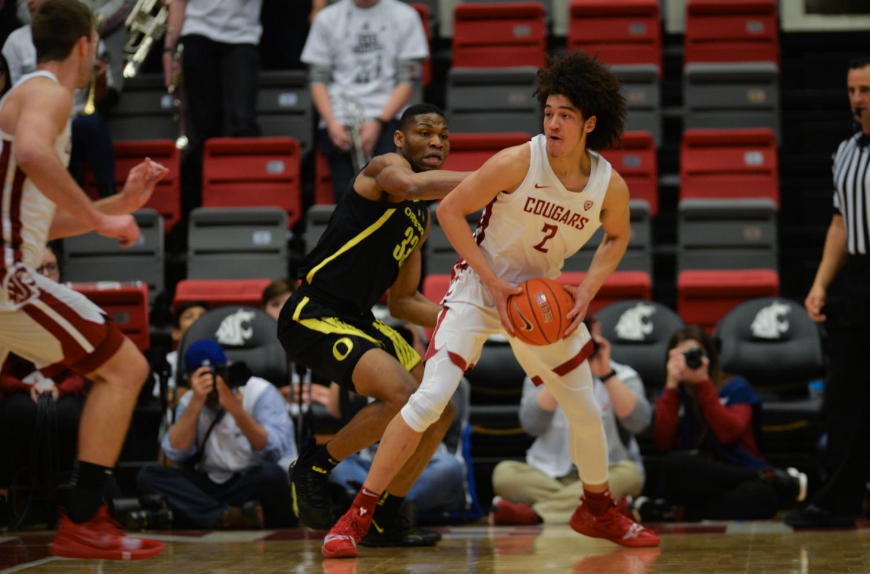 WSU freshman forward CJ Elleby looks to make a play in game against Oregon freshman forward Francis Okoro Wednesday night at Beasley Coliseum.