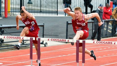 Then-junior Christapherson Grant, left, and then-sophomore Nick Johnson prepare to jump over hurdles during the WSU-UW Dual meet on April 28, 2018 at Mooberry Track.