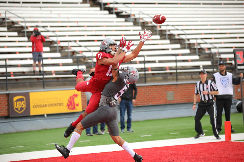 Senior receiver Dezmon Patmon attempts to catch a pass from redshirt senior quarterback Trey Tinsley during the Crimson and Gray on Saturday in Martin Stadium.
