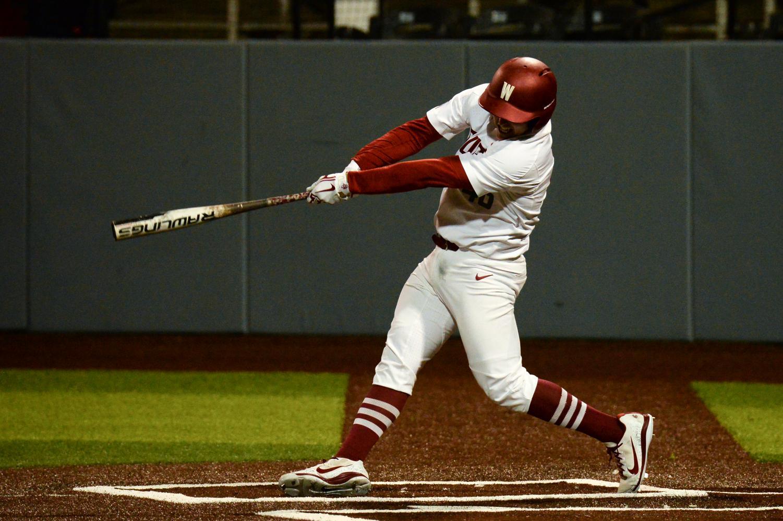 Freshman catcher Bradley Polinsky swings his bat during the game against Oregon on Apr. 12 at Bailey-Brayton Field.
