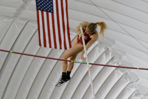 Redshirt junior Molly Scharmann clears the bar in the pole vault at the WSU Indoor Meet on Jan. 19 at the Indoor Practice Facility. Scharmann placed first in the event with a vault of 3.90 meters.