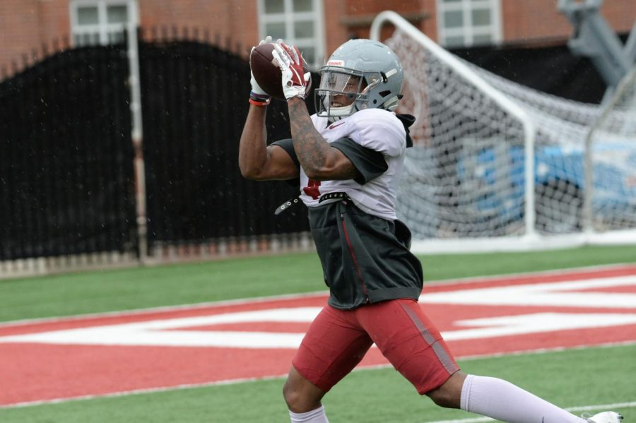 Senior cornerback Marcus Strong catches the ball while participating in a drill on Tuesday at Rogers Field.