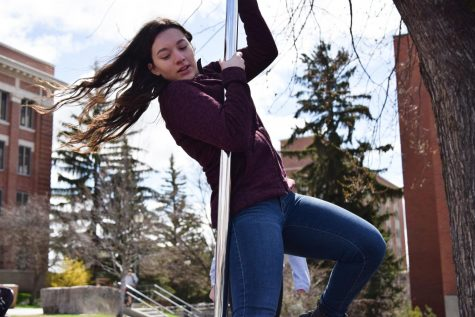 Sophomore psychology major Alyssa Castrillon practices on a pole in preparation for Cabaret Night, an event put on by the Aerial Dance Society, on Wednesday at the Glen Terrell Friendship Mall. Cabaret night will take place on Saturday, April 13 in the Jones Theater.