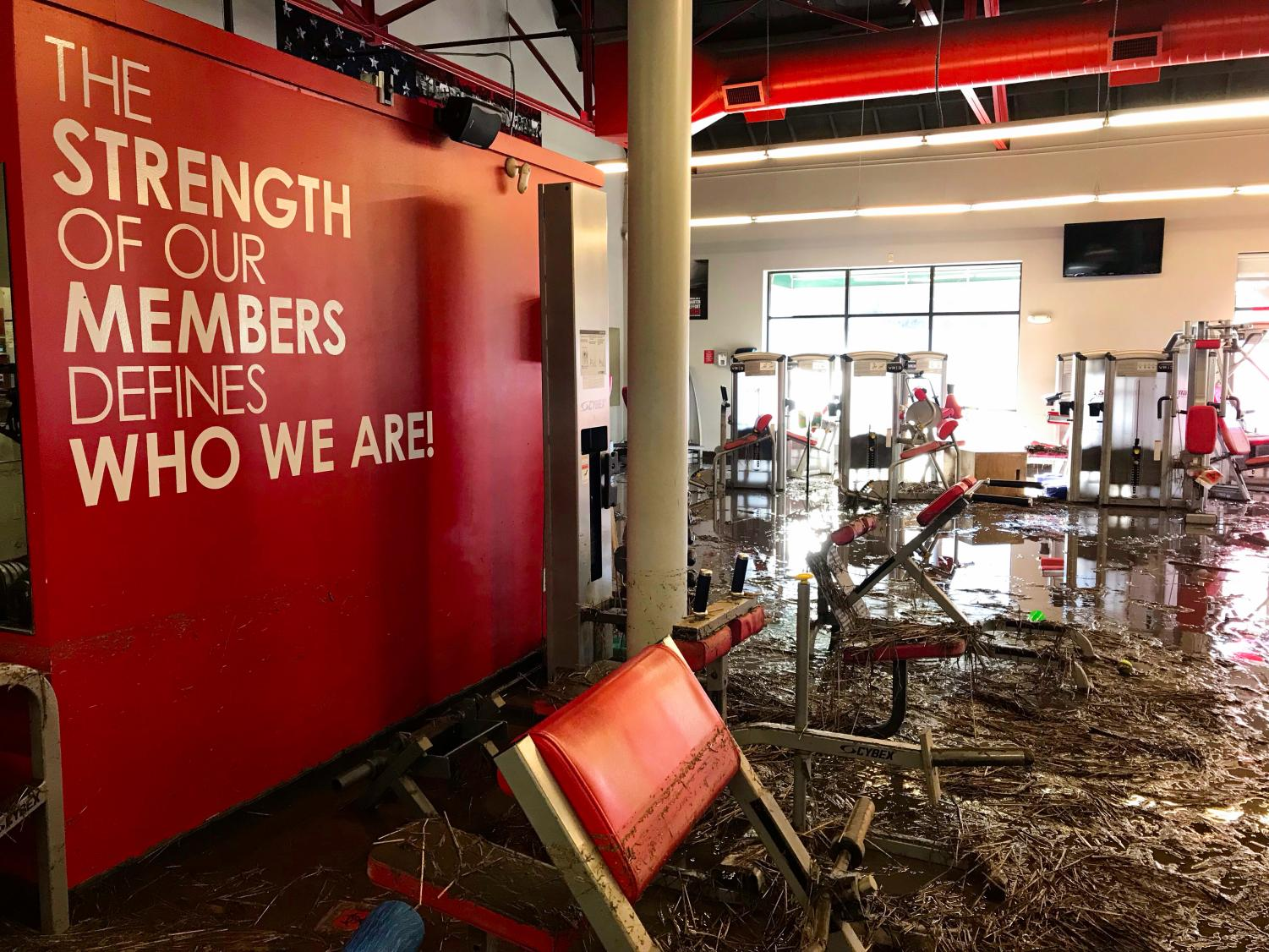 Flooding last week made all exercise equipment in Snap Fitness unusable. There was mud and debris covering the entire floor.