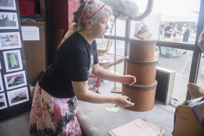 An artist displays her works at Pullman ArtWalk, since renamed Pullman ArtFest.