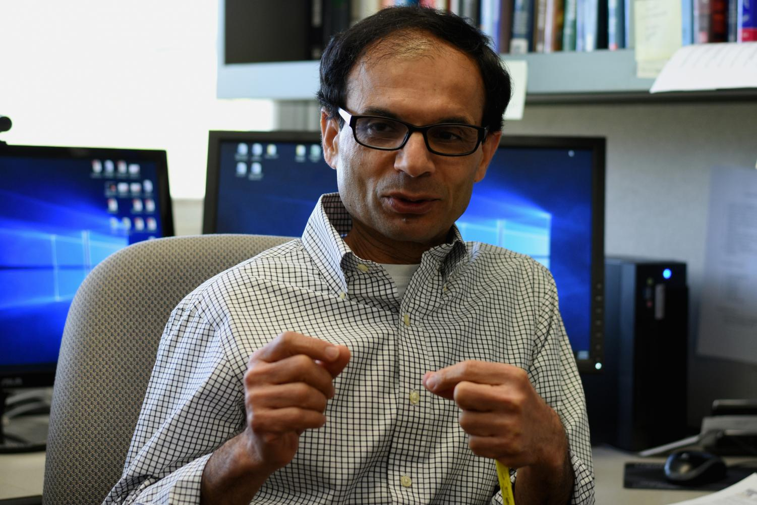 Professor of biological systems engineering Shyam Sablani discusses a new spoiled milk detector May 8 in the LJ Smith Building. These detectors will change color so that consumers can tell when the milk spoils.