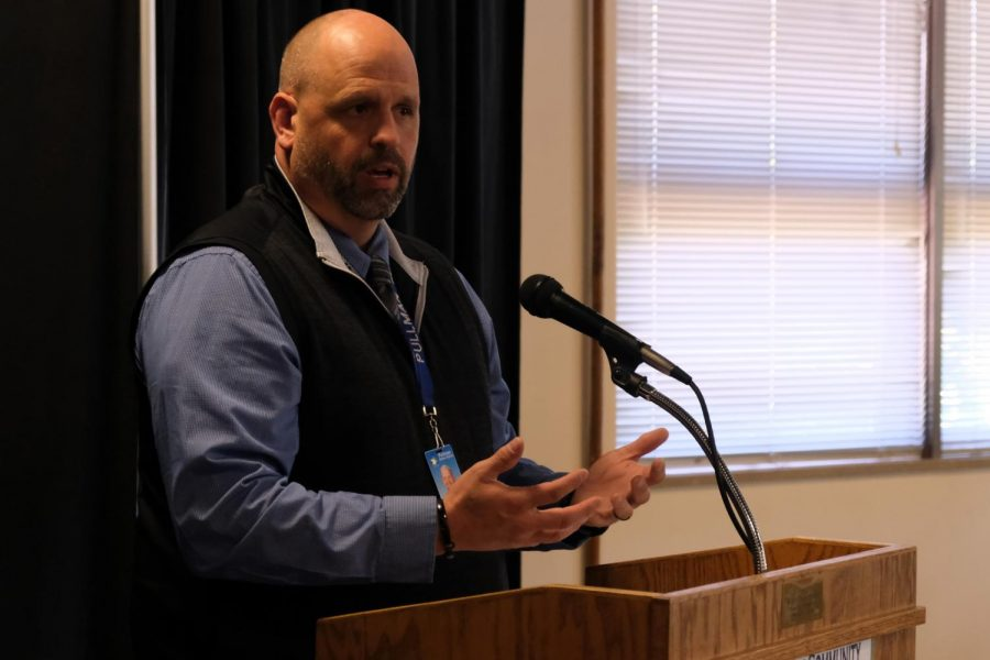 Chris Franklin, Assistant Principal of Athletics and Activities at Pullman High School, speaks on how the donation from the Pullman Chamber of Commerce and Visitor Center Community Investment Fund will go towards outfitting student athletes with special sensors meant to gather data on concussions during a Chamber meeting Tuesday afternoon at the Gladish Community Center.