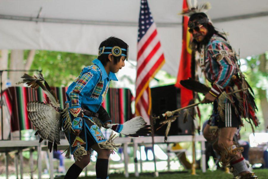 Teddy George Sr. dances alongside a young boy Saturday, May 18 near Lapwai, Idaho, for a Nez Perce cultural celebration.