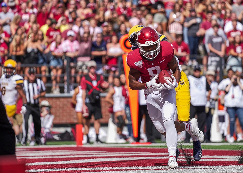 Redshirt senior wide receiver Easop Winston Jr. scores a touchdown against University of Northern Colorado on Sept. 7 at Martin Stadium.