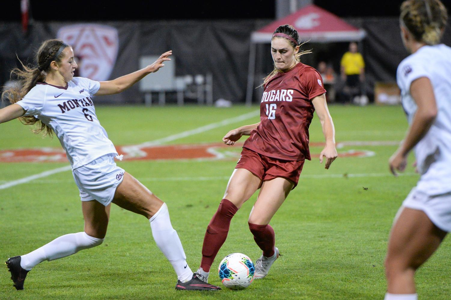 Graduate midfielder Averie Collins protects the ball from Montana junior forward Alexa Coyle on Friday at the Lower Soccer Field in Pullman.