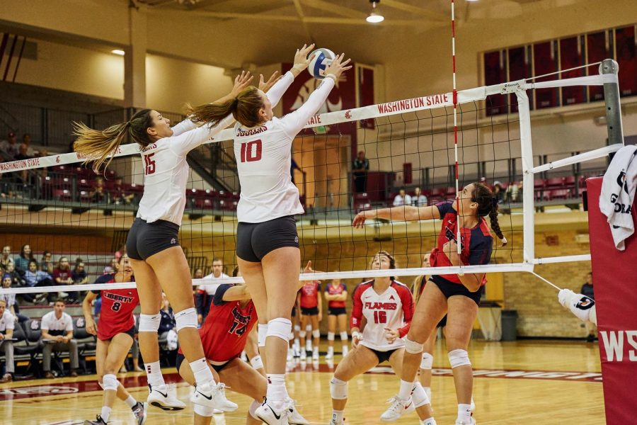 Freshman+outside+hitter+Alexcis+Lusby+and+middle+blocker+Magda+Jehlarova+block+a+shot+from+Liberty+University+outside+hitter+Lilly+Kruse+on+Saturday+in+Bohler+Gym.