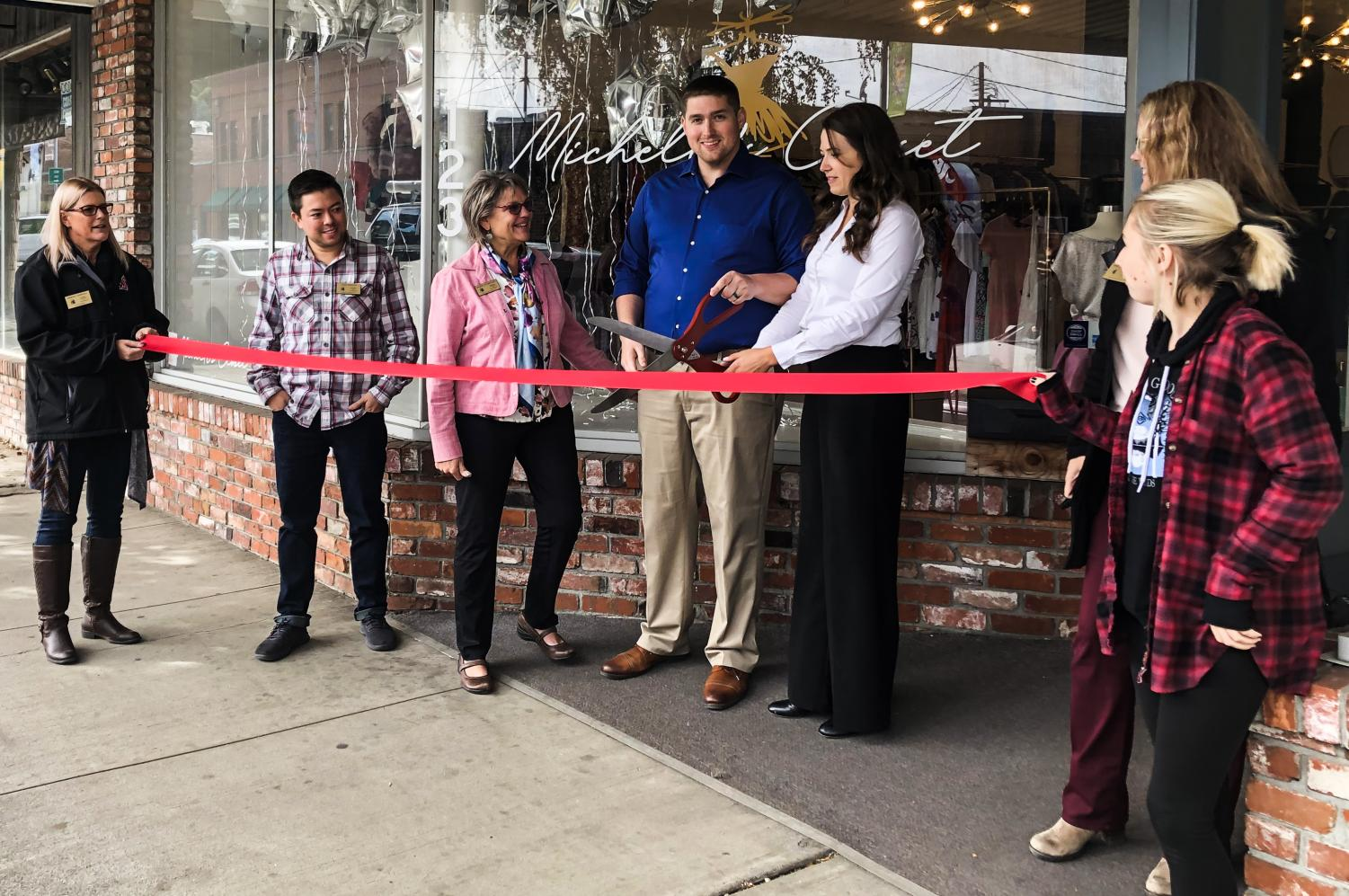 Michelle's Closet owners Michael and Michelle Kelly cut the ribbon outside of their store at their grand opening at noon Tuesday in downtown Pullman. The store will operate as a consignment shop for men's and women's clothing.