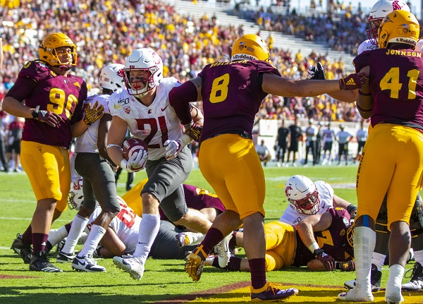 Washington State sophomore runningback Max Borghi scores a touchdown during a game against the Arizona State Sun Devils on Saturday afternoon in Tempe, Arizona.
